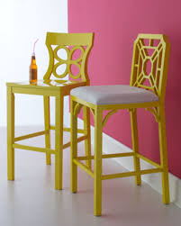 lilly pulitzer home decor with two wooden chairs and a pink wall lilly pulitzer home decor with two wooden chairs and a pink wall