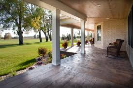 design spotlight porches custom builder this porch features integrated lighting and sound systems above and the custom stamped concrete below mimics the look of hardwood photos deb tschurwald