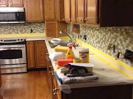 how to cheaply update kitchen cabinets how to paint kitchen cabinets our best tips tricks the