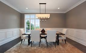 traditional dining room with pendant light by a perry homes