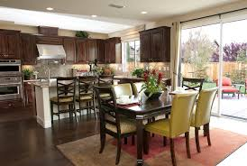 remarkable kitchen design with dining room and green chairs also