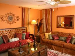 this eclectic living room features a rich orange and red color