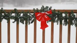 Christmas Fence Decorations Winter Storm Blowing Outdoor Christmas Red Bow Decoration On A