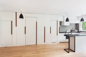 minimalist small apartment with hidden bedroom and storage closets