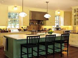 green wooden kitchen island with white top completed with black