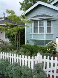 english cottage house cottage style with picket fence