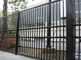 stalwart ii anti ram vehicle barrier with ornamental steel fence