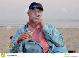 martini beach middle aged man smoking cigar and drinking martini on the beach