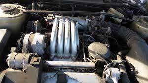 rattletrap jeep engine junkyard find 1990 cadillac allanté