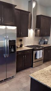 no backsplash in kitchen colors for a kitchen with cabinets purple drawer knobs