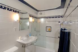 Art Deco Style Light Fixtures by Attic Shower Room With Mosaic Tile Stripe Shower Room Ideas