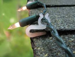 how to hang icicle lights how to hang christmas lights on your roof line and gutters
