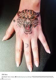 kesha shows off her new tiger tattoo on instagram daily mail online