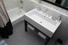 modern washstand with gray hex tile floor contemporary bathroom
