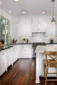 two tone kitchen cabinets with black countertops 30 two tone kitchen design ideas for remodeling