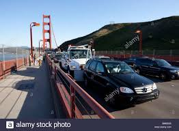 golden trucks car being pushed by a tow truck on the san francisco golden gate