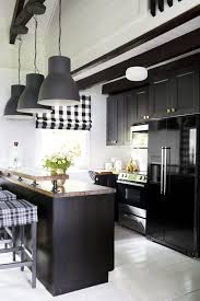 black bottom and white top kitchen cabinets 11 black kitchen cabinet ideas for 2020 black kitchen