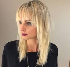 hairstyles with fringe bangs women s long blonde shaggy layered cut with fringe bangs