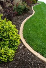edging by field of dreams landscaping and concrete