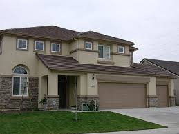 brown cream exterior house paint with dark brown roof paint