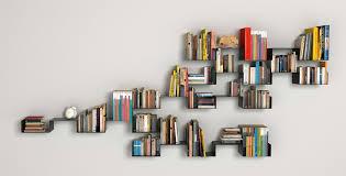 floating black wooden shelf brackets plus shelves for books placed