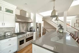 gray countertops with white cabinets west bay newport beach beach style kitchen orange county by