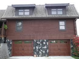 fatezzi faux wood garage doors clopay gallery door gd1su in walnut ultra grain color garage