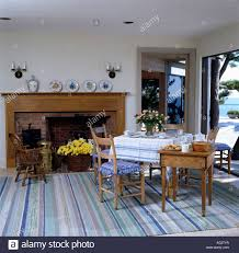 Dining Room With Fireplace by Seaside Dining Room With Wooden Fireplace And Pastel Blue Striped