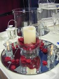 hurricane centerpiece with pillar candle and rose petals cakes