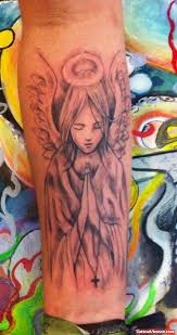 praying angel tattoo on leg tattoo viewer com