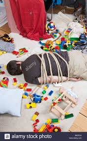a tied up man in a children u0027s playroom stock photo royalty free