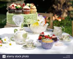 Tea Party Table by Outdoor Tea Party Dessert Table With Flowers And Cupcakes Stock