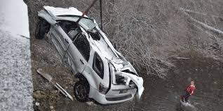 crash sends suv 40 feet off bridge into fall creek