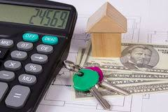 House Building Calculator Model Of Cardboard House With Key Calculator And Cash Dollars