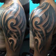 75 tribal arm tattoos for interwoven line design ideas