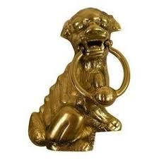 foo dog door knocker foo dog guardian lion thundering through thousands of years