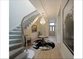 grey carpet on stairs combined with wood colour on ground floor