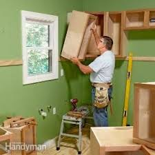 install cabinets like a pro the family handyman how to install cabinets like a pro cabinet makers kitchens and