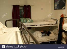 Dormitory Bunk Beds Person Sleeping In Bunk Bed In A Hostel Dormitory Byron Bay Nsw