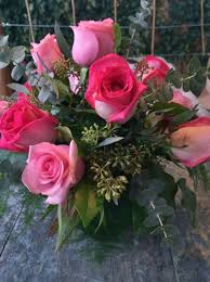 one dozen roses one dozen roses and greens with accents in a clear glass cube