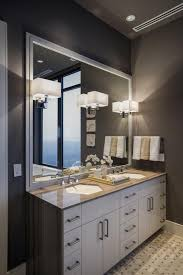 square modern bathroom vanity lights on extensive framed mirror