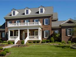 front porches on colonial homes colonial brick house with black shutters hgtv home