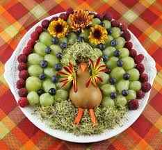 adorable turkey fruit platter with flower wings and sprout hair