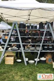 outdoor craft show lighting pottery and glass displays