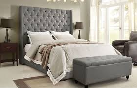 bedroom tufted high headboards for beds with curved table lamp on
