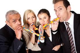business team celebrating birthday management training courses