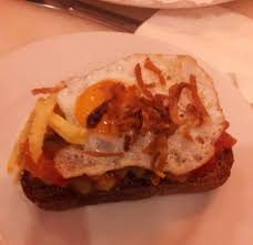 canape madrid canape of ratatouille with fried egg and caramalized garnish
