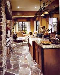 tuscan kitchen with stone flooring and large island with quartz
