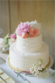 simple wedding cakes top a buttercream covered cake with pretty flowers and voilà
