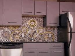dark grey kitchen cabinet ornamental mosaic kitchen backsplash